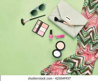 Fashion Stylish clothes, Accessories. Urban Summer girl colorful Outfit. Cosmetics, makeup. Glamor handbag clutch, trendy pants, sunglasses. Woman fashionable summertime  essentials