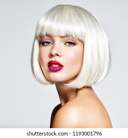 Fashion Stylish  Portrait with White Short Hair. Beautiful Girl's Face with Haircut. Hairstyle. Fringe. Professional Makeup. Make-up.  Fashion portrait of woman with bob hairstyle. Vogue Style Woman.