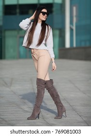 Fashion stylish woman street style shooting in  knee-high boots