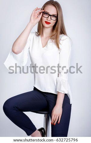ce78be461ad3 Fashion successful business woman in glasses smiling portrait over white  background. Vogue style girl wear elegant white blouse and glasses at  studio.