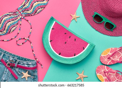 Fashion. Summer clothes, Accessories set. Beach Outfit. Flat lay. Trendy Swimsuit Bikini, Stylish Sunglasses. Creative Art Color.  Hot Vibes. Vacation Concept