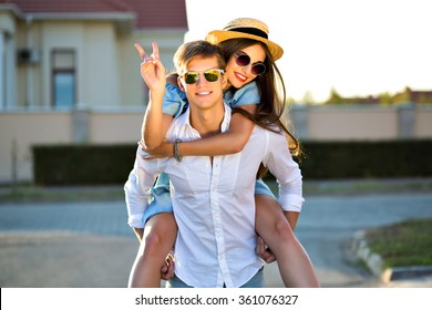 Fashion summer image of elegant vintage styled couple in romantic valentine day, having great time together, hugs and kisses, hipsters, stylish clothes and sunglasses, beautiful lovers, family outdoor