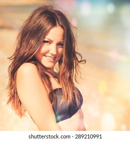 Fashion summer outdoor portrait of beautiful young woman. Hipster style. young pretty girl with long hair posing at beach. Photo with instagram style filters