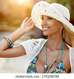 Fashion summer portrait of joyful beautiful blonde woman in hat. Close up