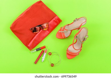 Fashion. Summer woman accessories- shoes,sunglasses ,purse bracelet on green background