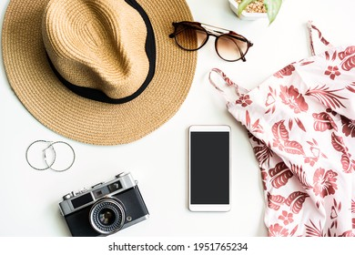 Fashion summer women's clothes set with accessories on white background with empty screen smart phone, Flat lay, Top view