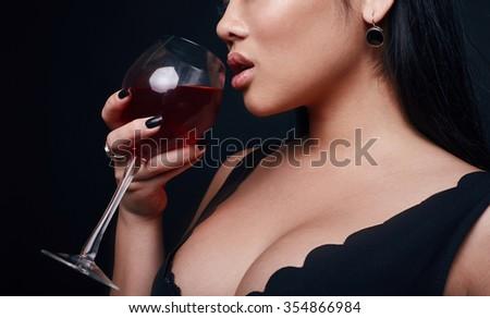 cdc0fdd4c15b Fashion swag portrait of beautiful elegant asian woman in formal dress with  vine on black background
