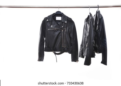 fashion three black leather punk jacket hanging isolated on hanger