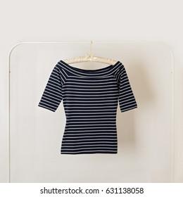 Fashion trend stripes. Blue top striped. Selective focus.