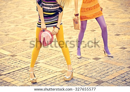 5d14fecc6d92e Fashion urban friends, outdoor. Woman sexy legs, pantyhose, stylish shoes,  clutches