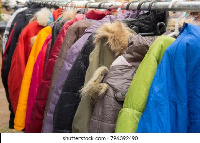 Fashion winter coats hanged on a clothes rack.