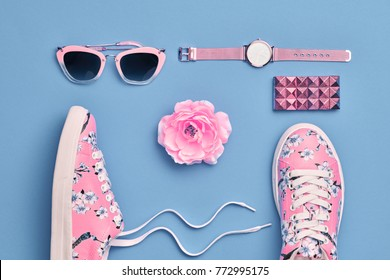 Fashion. Woman Accessories Set. Flat lay. Trendy Watch, Summer Sunglasses, Glamour Pink Floral Sneakers. Flower. Stylish fashionable Hipster Girl. Pastel summertime Color