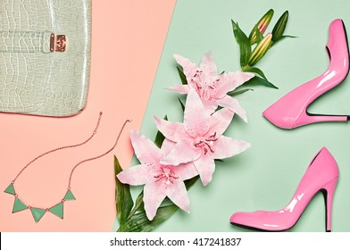 Fashion woman accessories set. Glamor heels, stylish handbag clutch and summer lily flowers. Elegant trendy girl. Unusual creative look. Vanilla pastel Lady outfit