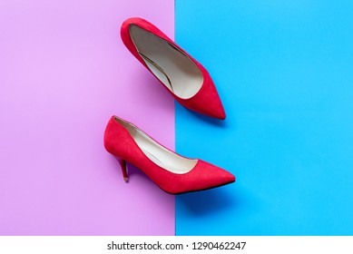 Fashion woman accessories set. Trendy fashion red shoes heels. Yellow pastel color background, top view and copy space. Fashion Concept.