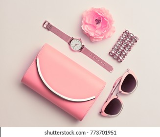 Fashion. Woman Accessories Set. Trendy Rose Gold Watch, Summer Sunglasses, Glamour fashionable Clutch. Flower. Flat lay. Luxury Stylish Spring lady. Pastel Color