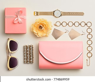 Fashion. Woman Accessories Spring Set. Trendy Watch, Summer Sunglasses, Glamour Pink Clutch. Flower. Layout. Luxury lady. Vanilla Color