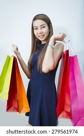 Fashion woman Asia portrait and Happy girl hold shopping bag
