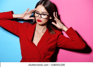 Fashion woman in glasses. Red jacket