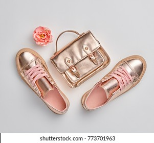 Fashion. Woman Gold Accessories Set. Flat lay. Trendy fashion Handbag, Glamour Shoes, Flower. Minimal Style. Luxury Spring Hipster Girl. Pastel Color