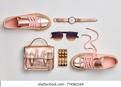 Fashion. Woman Gold Accessories Set. Trendy fashion Handbag, Shoes, Glamour Sunglasses, Stylish Watch. Layout. Luxury Hipster Girl Outfit. Pastel Color