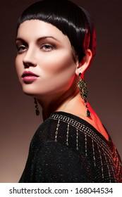 Fashion woman  in green chiffon  dress. Trendy makeup.  Gold jewelry accessory