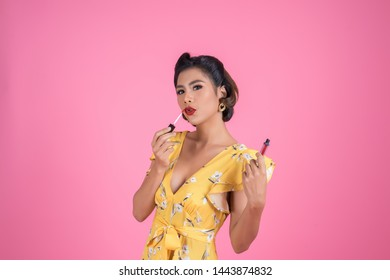 Fashion woman hand holding lip care