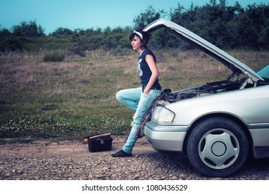 Fashion woman having troubles with the car