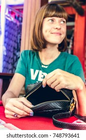 Fashion woman with luxury snakeskin python handbag on the wooden table in restaurant. Bali island.