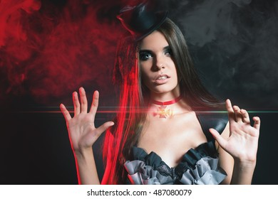 Fashion woman at night club. Celebrating Halloween or New Year! Beautiful costume for carnival. Holiday