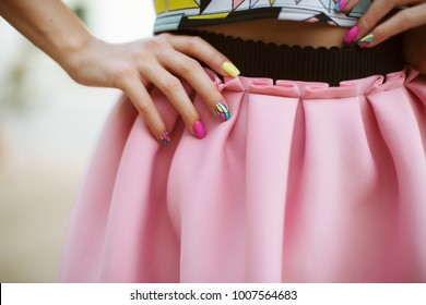 Fashion woman with pink skirt and Pastel manicure