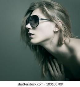Fashion woman portrait wearing sunglasses