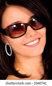 fashion woman portrait where she is smiling and wearing sunglasses