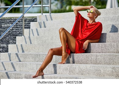 Fashion woman in red dress outdoor portrait