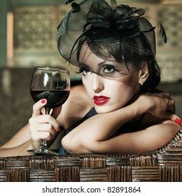 Fashion woman retro portrait in a restaurant