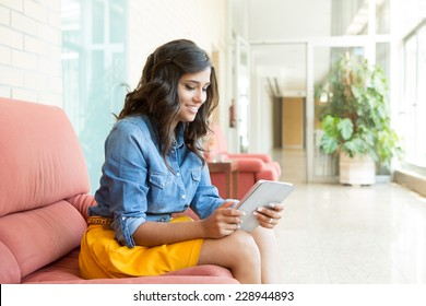 Fashion woman using tablet with background light  - Shutterstock ID 228944893
