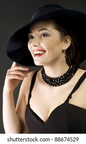 Fashion woman wearing hat laughs