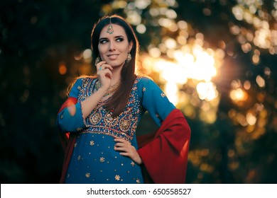 Fashion Woman Wearing Indian Costume and Jewelry Set - Beautiful girl wearing a salwar kameez with matching earrings, mangtika and necklace