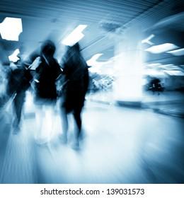 fashion women in shopping center abstract blur