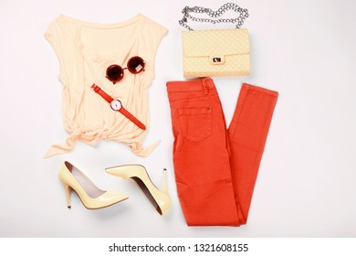 Fashion women's clothes on white background. Living coral color