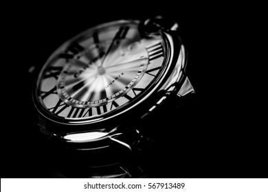 fashion wrist watch isolated on a dark background.black & white.blurred background