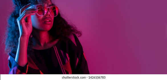 50f192761 Fashion young african girl black woman wear stylish pink sunglasses glasses  looking at camera isolated on