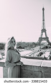 Fashion young blonde woman portrait in Paris.