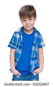 A fashion young boy is standing against the white background