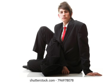 Fashion young businessman black suit casual red tie on isolated white background