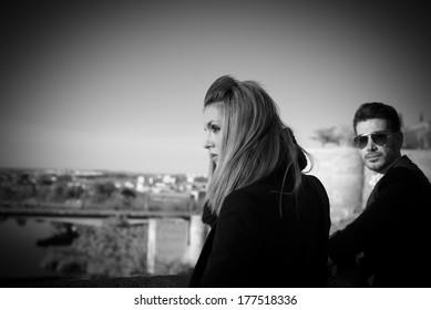 Fashion young couple in black and white in Toledo, Spain