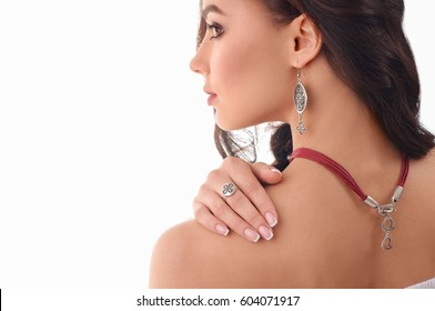 fashion young girl with long brown hair, fresh skin, wearing accessories and jewelry, isolated over white background