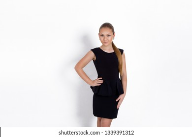 Fashion young girl, teenager model in elegant dress on a white background in the studio- image