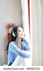 Fashion young woman wearing headset, listen to music