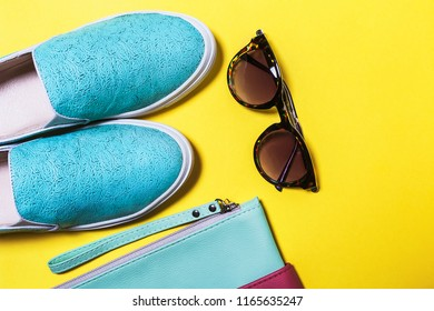 fashionable accessories for ladies. modern sunglasses, colored bag and aquamarine shoes. Spring summer hipster trend. Top view. mockup for instagram. free space for text