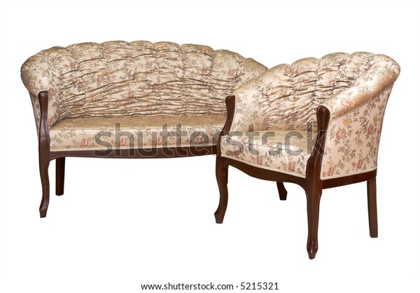 Fashionable armchair and sofa on a white background